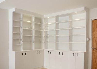 Bookcase and cupboards. LED spots and adjustable shelves