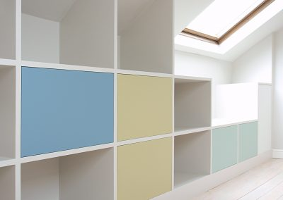 Bookcase with colourful fronts